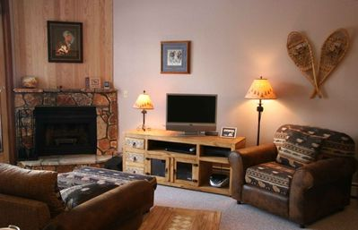 Silverthorne condo rental - View of Living Room with wood burning fireplace - your firewood is included