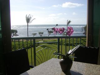 Waipouli condo photo - Sit in the living room and feel the ocean breeze! Enjoy a meal or cocktail !