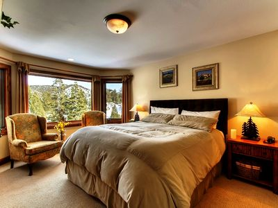 Large bedroom with bay windows