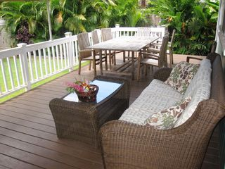 Sunset Beach house photo - Enjoy lounging and eating outdoors with the palm trees swaying