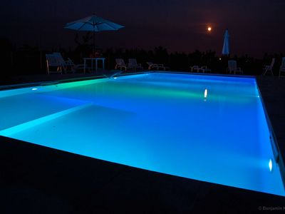 The pool lit up with Led lights that change colour