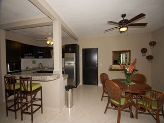 Playacar condo photo - Kitchen and dining area.