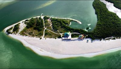 Private Island beach. Take our own boat shuttle to beach with chairs & umbrellas