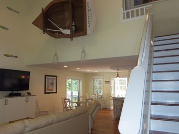 South Haven house rental - Entrance of Home. Paddle Railing and Unique Light up Row boat in the Living Room