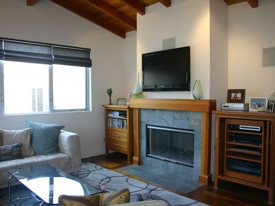 Family room - in-home entertainment system and fireplace