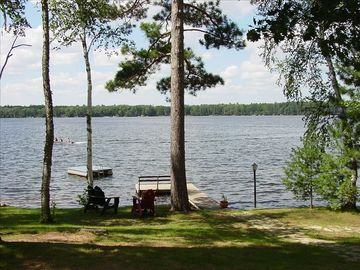 Manitowish Waters cabin rental - Lakeshore view - 400 feet of sandy shoreline, two private piers