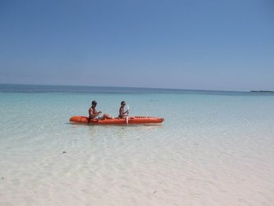 A romantic kayak ride in front of the villa - pink sand, turquoise gin-clear sea