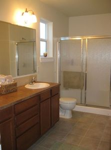 Master bath with walk in closet and linen closet stocked with extra linens.