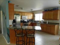 3/2 on Salt Water Canal with screened pool.  (Minimum 30 day rental!!!)