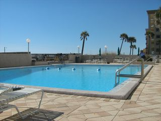The swimming pool is ready for you to cool off in with plenty of lounge chairs. - Fort Walton Beach condo vacation rental photo
