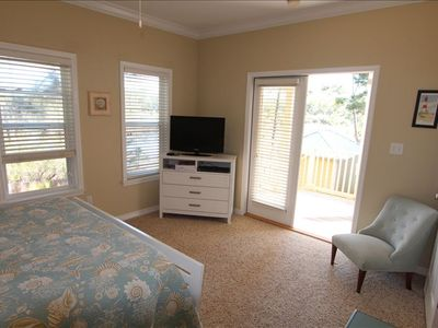 Master bedroom with doors to the outside deck.