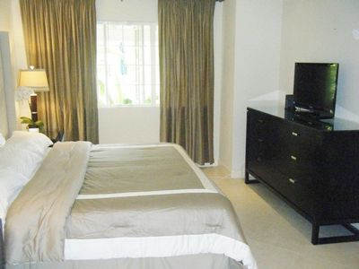 Master Bedroom with views of the garden and pool, with TV, DVD and cable