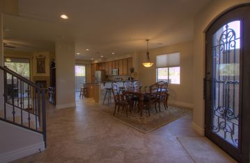 Wide open entry area - view to dining and kitchen and front door.