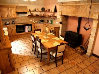 St Cyprien house photo - Kitchen with stone fireplace and log burner