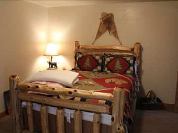 First floor guest bedroom #4 (log queen bed)