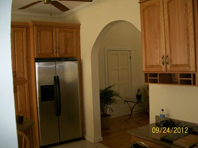 Partial view of kitchen showing stainless steel refrigerator with icemaker