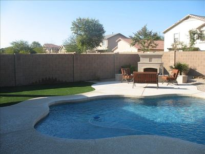 Outdoor fireplace and heated swimming pool.