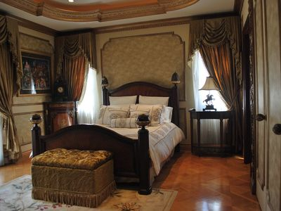 Luxury Defined, Guest bedroom with Queen bed.