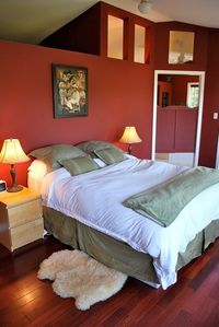 Wake up to a magnificent view of Sechelt Inlet from queen bed in master bedroom.