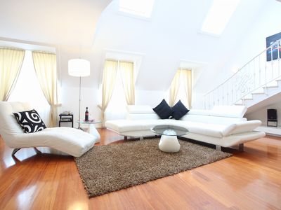 Bright and spacious living room with comfortable sofas
