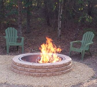 Enjoy relaxing sitting outdoors while watching a campfire near Broken Bow Lake