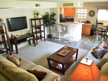Palm Springs condo rental - Awesome living room with sectional and Plasma Screen TV