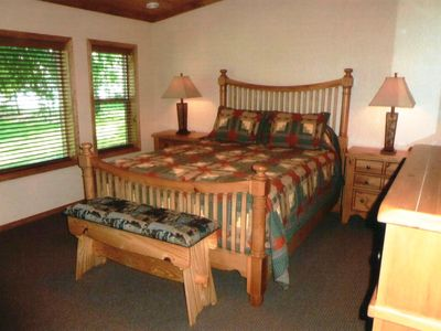 The master suite features a queen bed, lake view, and ensuite bath.