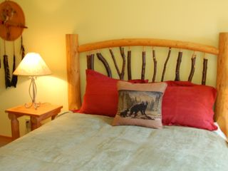 Canmore condo photo - Master bedroom w/ Native heritage decor