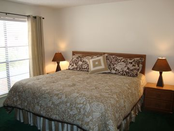 Master bedroom with king size bed with full bath