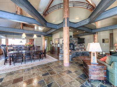 The wide open floor plan allows for viewing and conversing from the kitchen to the dining area to the living room. Large timbers and steel I beams make for this architecturally unique space