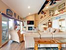 """Living Room - Seating for 6 in the sunlit living room, plus a 60"""" TV and fireplace."""
