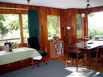 Cherry paneled dining room w/ South & West picture window views