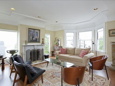 San Francisco apartment rental - Beautiful, spacious living room with views of downtown SF and Bay Bridge.