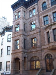 Facade of 1892 Brownstone, 110 West 81 Street in center, parlor floor and up