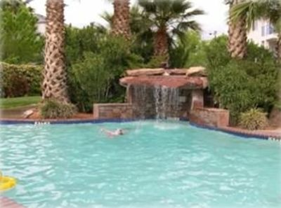 6 beautiful pools,this one located behind our condo,hot tub behind waterfall