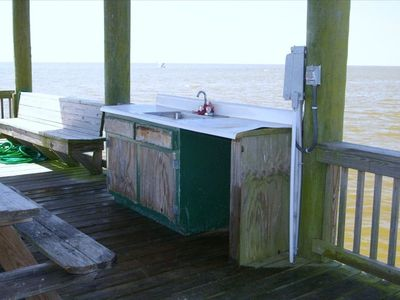 fish/crab cleaning station/ end of the pier. swim platform/ with steps too.