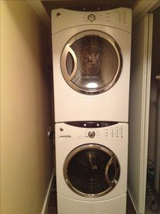 Super capacity General Electric washer and dryer located in basement.