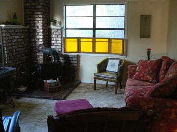 Mount Nebo house rental - Cozy den with wood stove.