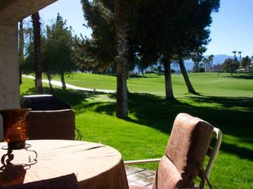Palm Desert condo rental - Outdoor dining with expansive lawn and great golf course views!