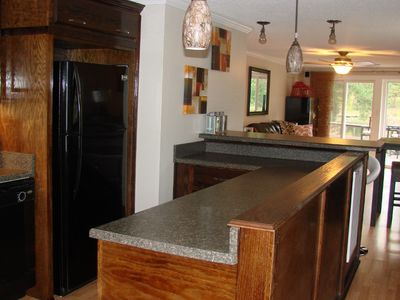Spacious Extra kitchen with large bar...