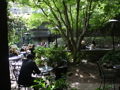 Arlequin cafe and wine shop garden. Great place to eat or share a bottle of wine