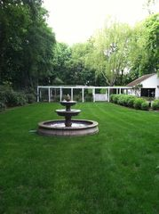 Bridgehampton house photo - fountain in side lawn