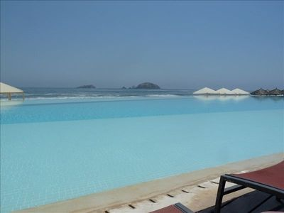 The gorgeous infinity pool that seems endless going into the ocean!