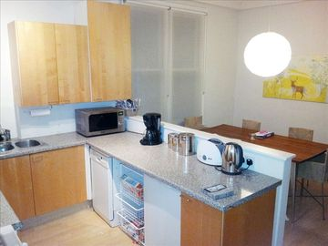 ... huge eat-in kitchen with ample room for dining and entertaining ....