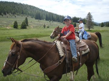 The kiddos having a horseback ride in Duck Creek Village.