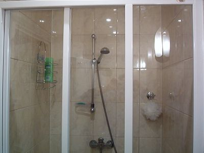 This is the shower in unit, super nice and clean, clean, clean. Porcelain Tiles