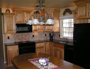 Crystal Mountain, Thompsonville house photo - Fully equipped kitchen adjoins living room