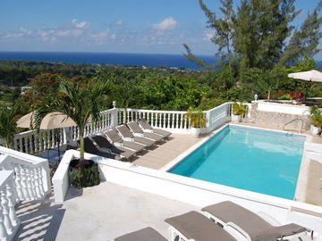 View over pool towards the ocean from one of the upper terraces