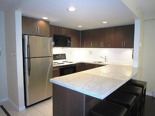 Vancouver townhome photo - Beautiful kitchen with granite counters, extensive cupboard & all appliances.