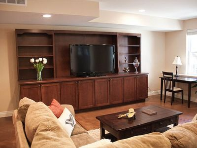 "Living room with entertainment center and 60"" flat screen TV. Comfortable couch!"